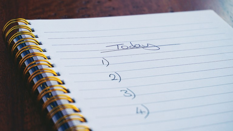 "a notebook with the words ""Today"" and the numbers 1-4 written on a page"