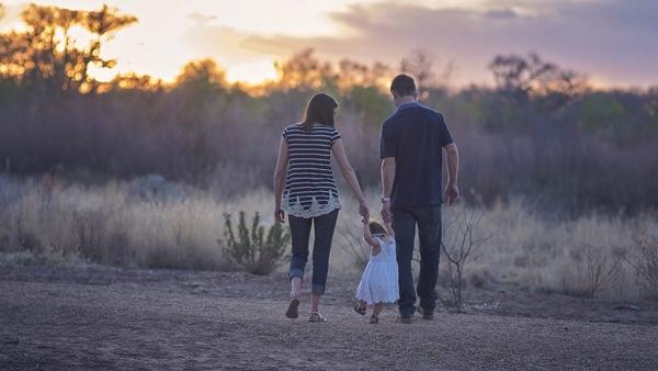 parents holding child