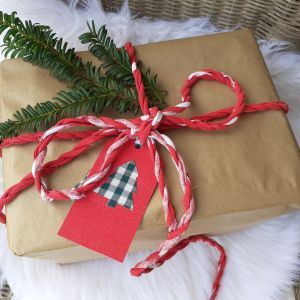 red fabric gift wrap twine and christmas tree tags