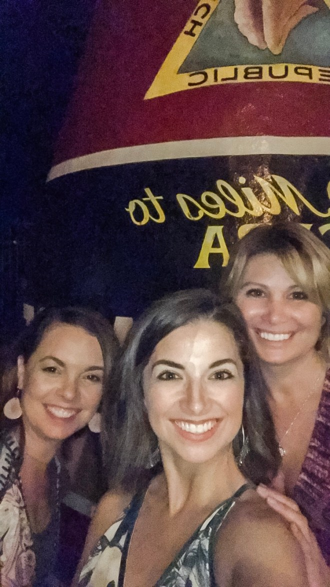 3 women smiling in front of the Southernmost Point sign in Key West, Florida