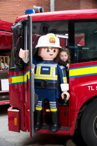 Playmobil partners with London Fire Brigade (LFB) to celebrate their 150th anniversary at Soho Fire Station yesterday (9th April, 2016) Life-sized Playmobil friend teaches little girl (Willow Marsh, aged 4) what a real LFB fire engine is like PIX:TIM ANDERSON