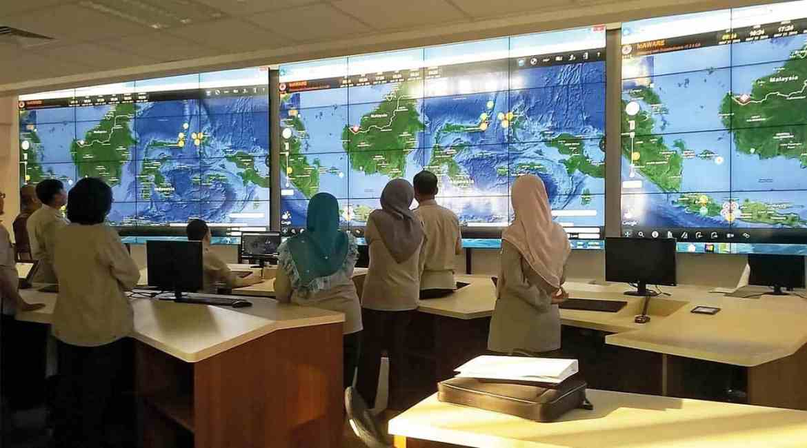 Staff at the emergency operations center of Indonesia's national disaster management agency, BNPB, monitoring hazards in InAWARE, a custom iteration of PDC's DisasterAWARE.