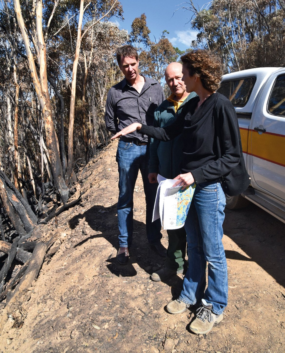 Dr Marta Yebra (right) examines the bush after a prescribed burn with Dr Matt Hayne from the Bushfire and Natural Hazards CRC and Dr Adam Leavesley.