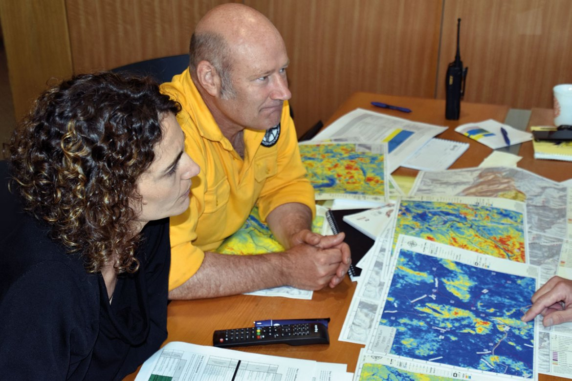 Dr Marta Yebra and Dr Adam Leavesley discuss the plans for a prescribed burn in the ACT.