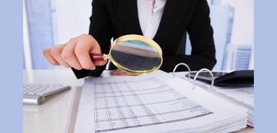 woman examining insurance reimbursements