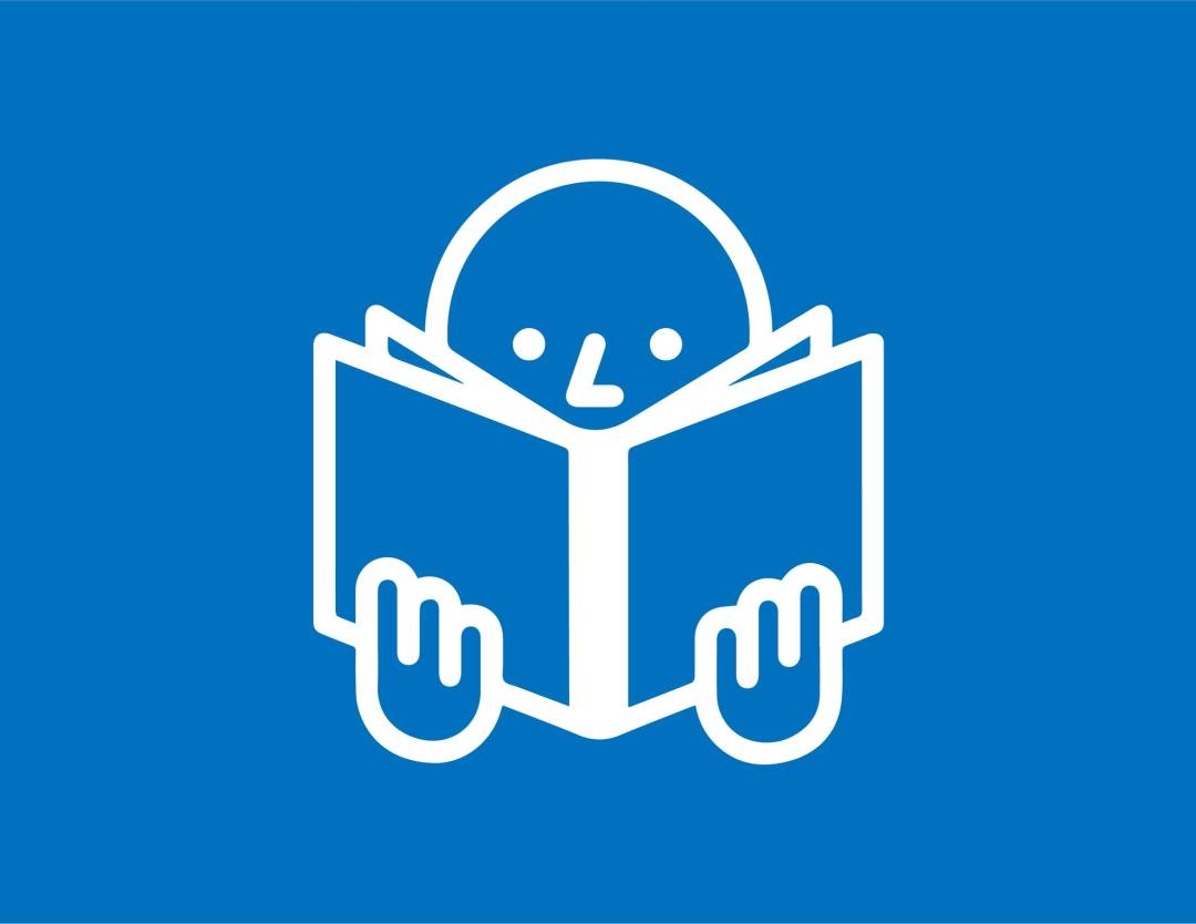 Someone reading content from a book icon