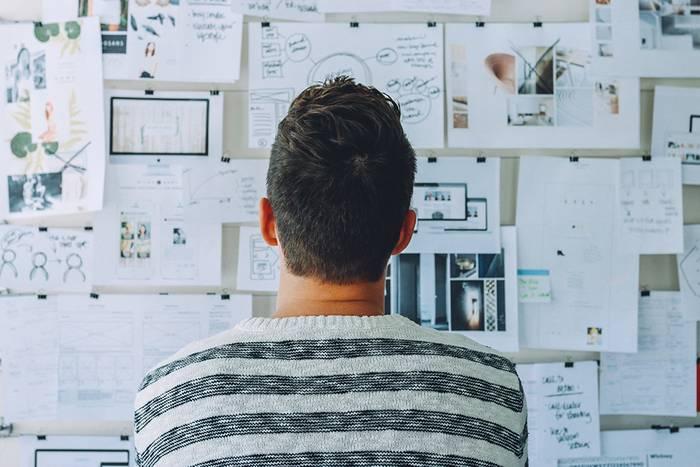 Man examining notes board