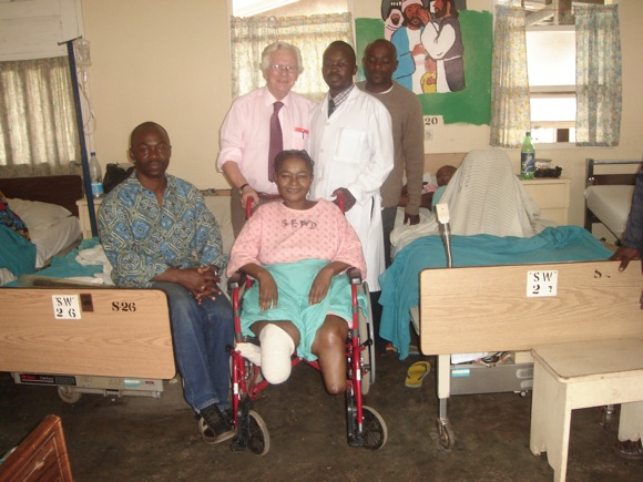 This patient at Mbingo Baptist Hospital lost both of her legs to diabetes. The delight she had in receiving this chair shows on her face.