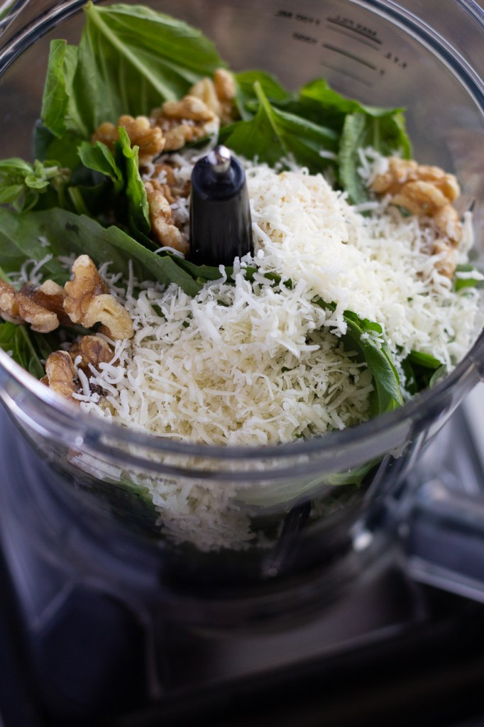 Fresh basil, walnuts, and parmesan cheese in food processor