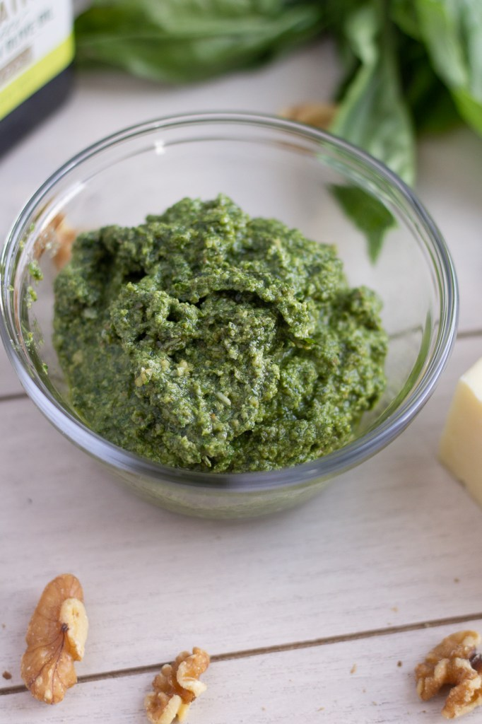 Bowl of homemade walnut pesto with olive oil