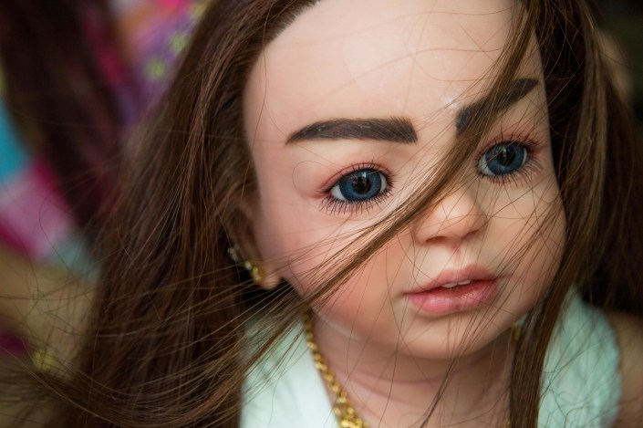 Millionaire, one of Mama Ning's favorite luk thep dolls on March 17, 2016.
