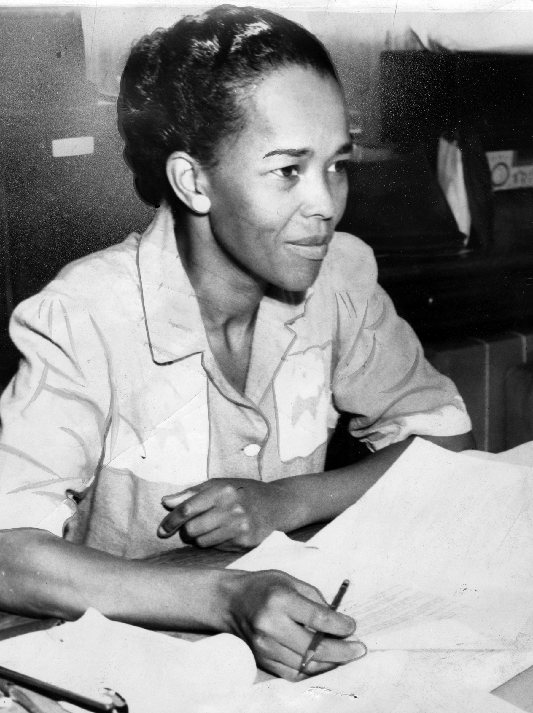 A photograph of Ella Baker as NAACP Hatfield representative, behind a desk with paperwork, Sept. 18, 1941. African American history facts