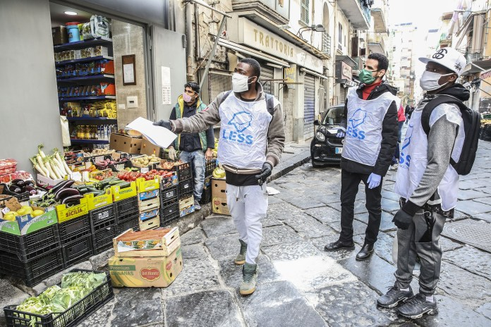 A group of migrants, who work together as volunteers with the Cooperative Poor, bring food bags and medicines to parents' homes, or who cannot shop, because of government restrictions or because of fear of corona virus infection.