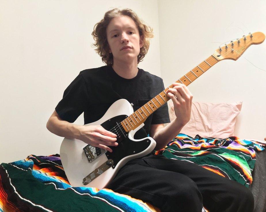 Ben Scofield, Drexel University Class of 2020, on his bed in his new apartment in the Bushwick neighborhood of Brooklyn