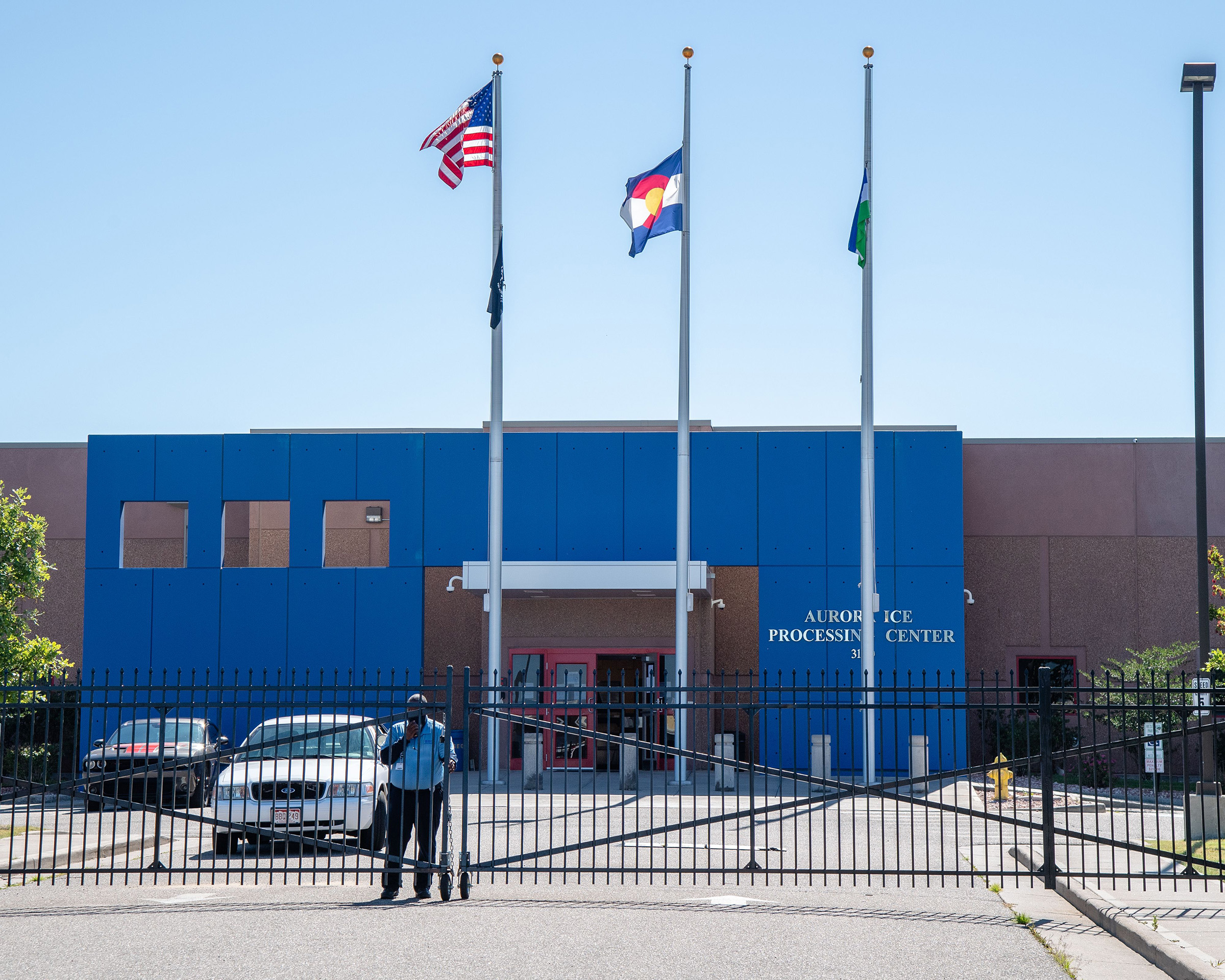 A security guard stands outside of the Aurora ICE Processing Center in Aurora, Colorado on July 5, 2020.