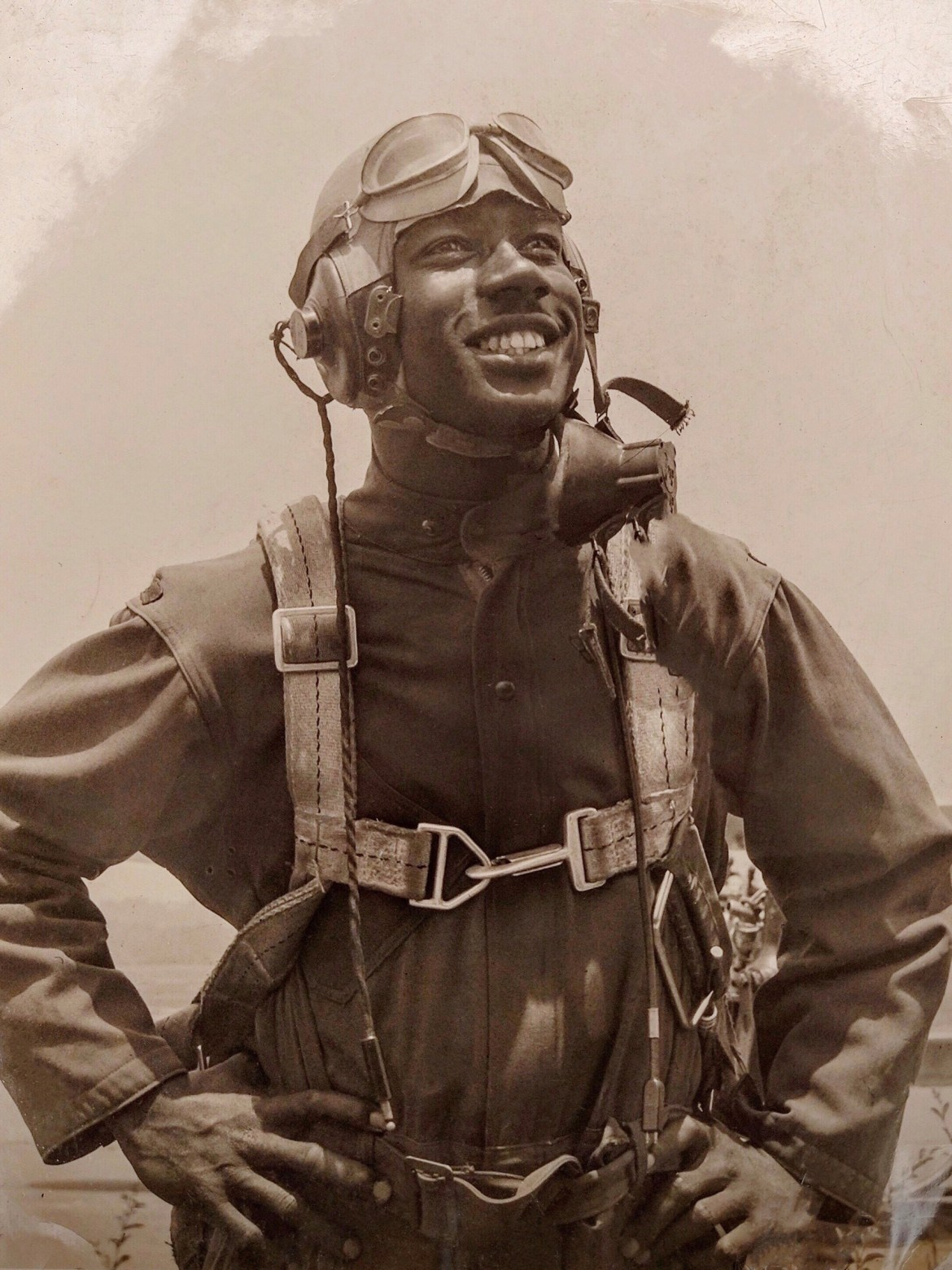 Wilkerson displays a photo in her home of her father in his Tuskegee Airmen uniform