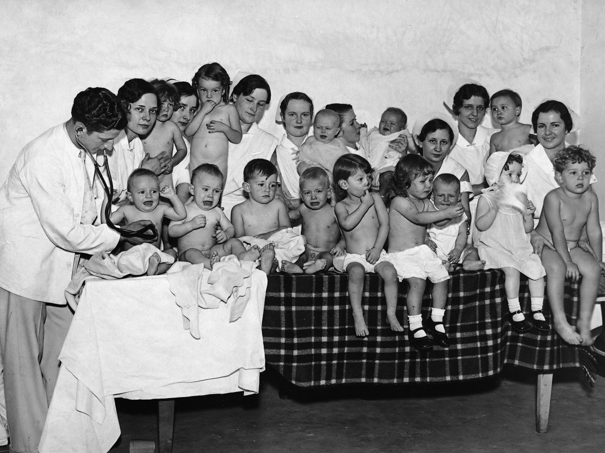 Dr L. Sherman examining some of the 983 children between 2 months and 5 years who have been entered into the Better Babies contest near Washington D.C. in 1931.