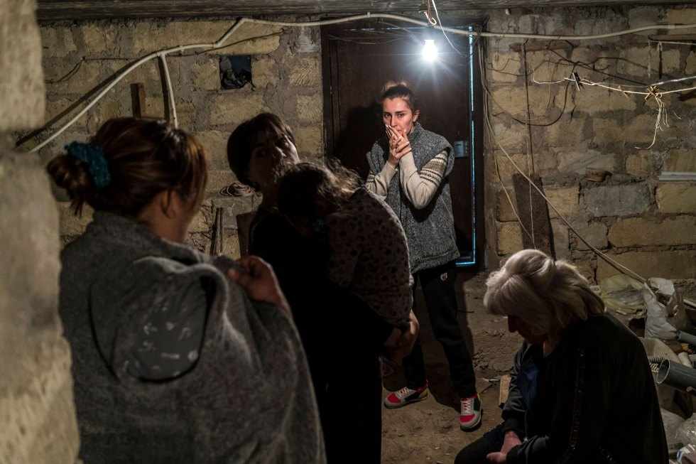 Residents shelter in a basement as air raid sirens sound on Sept. 29, 2020 in Stepanakert, Nagorno-Karabakh