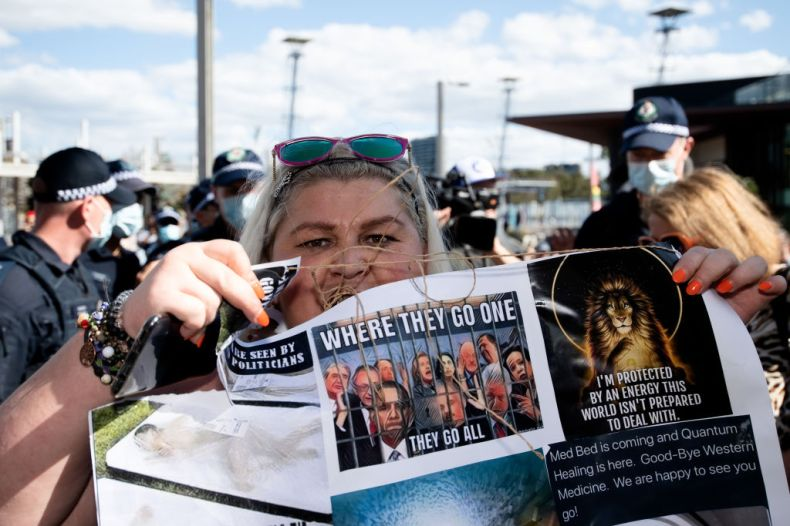 A protester holds a sign up during the Freedom Day Rally in Sydney on Sept. 5, 2020.