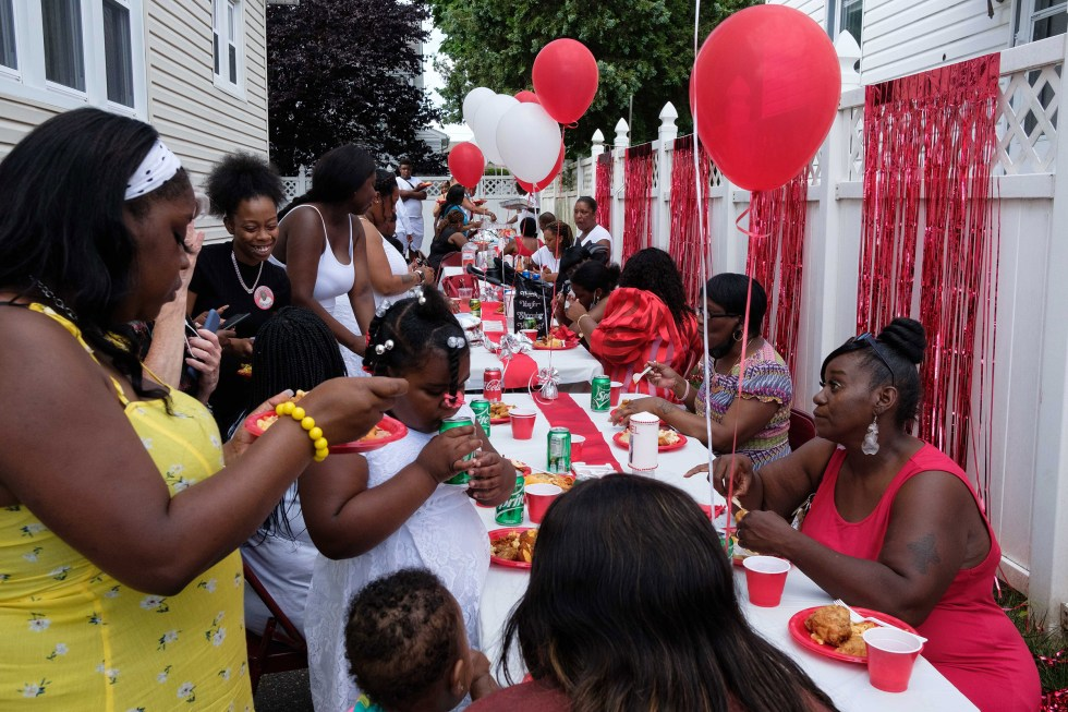 Family members gather for dinner at Jamel Floyd's house after the funeral and burial.