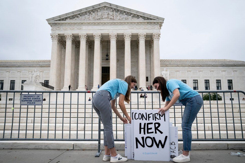 Liberty University students with signs in support of the nomination of Judge Amy Coney Barrett outside the Supreme Court in Washington, Sept. 26, 2020. (Erin Schaff/The New York Times)