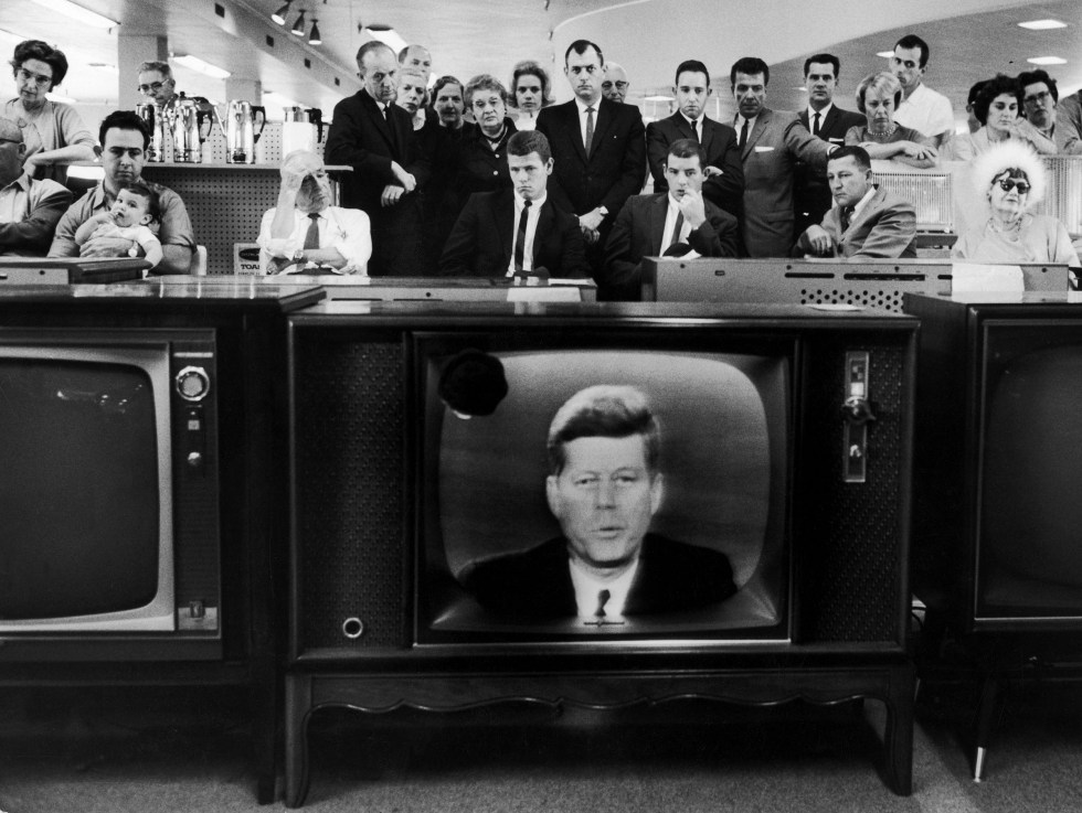 People watching Pres. John F. Kennedy's TV announc