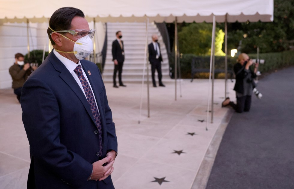 U.S. Service members wear masks and eye protection before President Trump's return to the White House from Walter Reed National Military Medical Center on Oct. 05