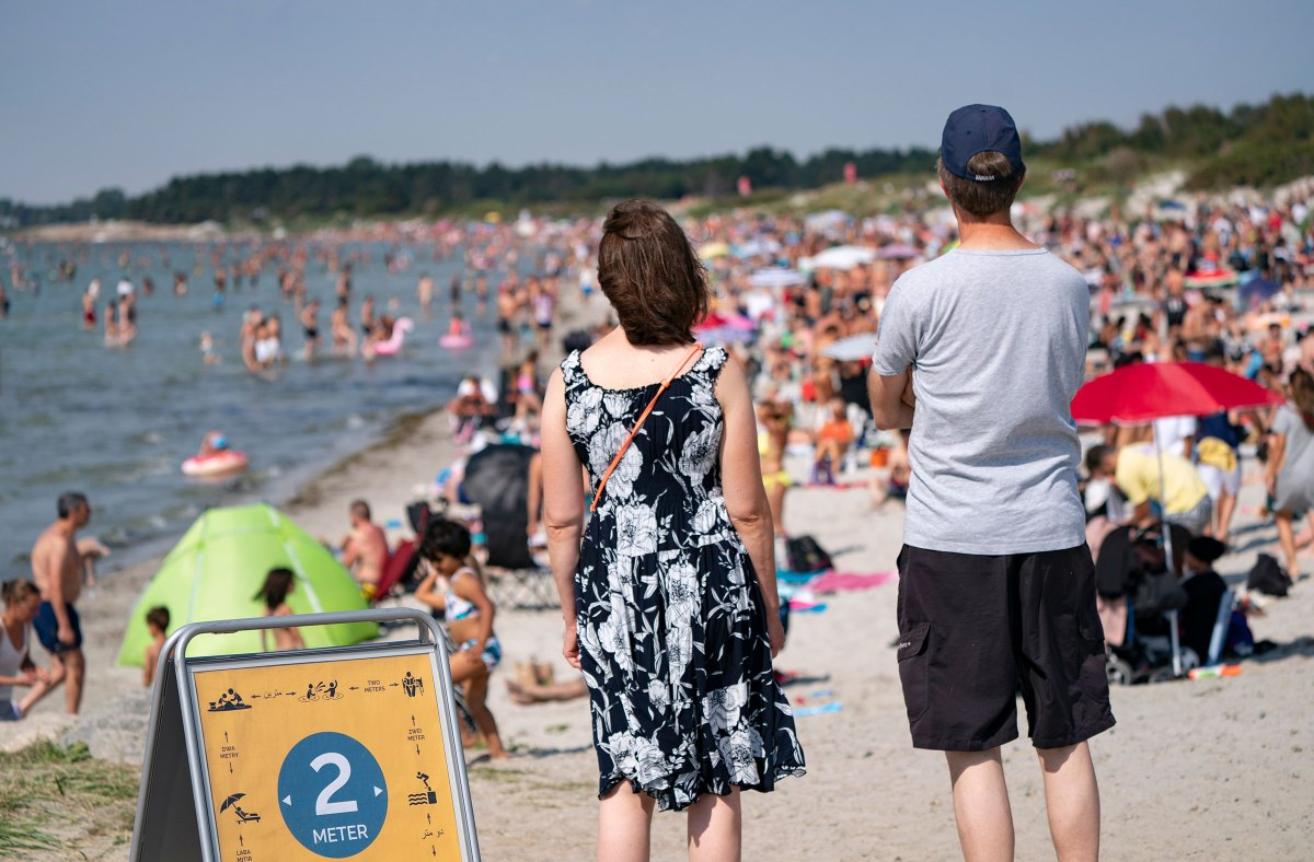 People on a crowded beach in Lomma, Sweden on Aug. 16, 2020.