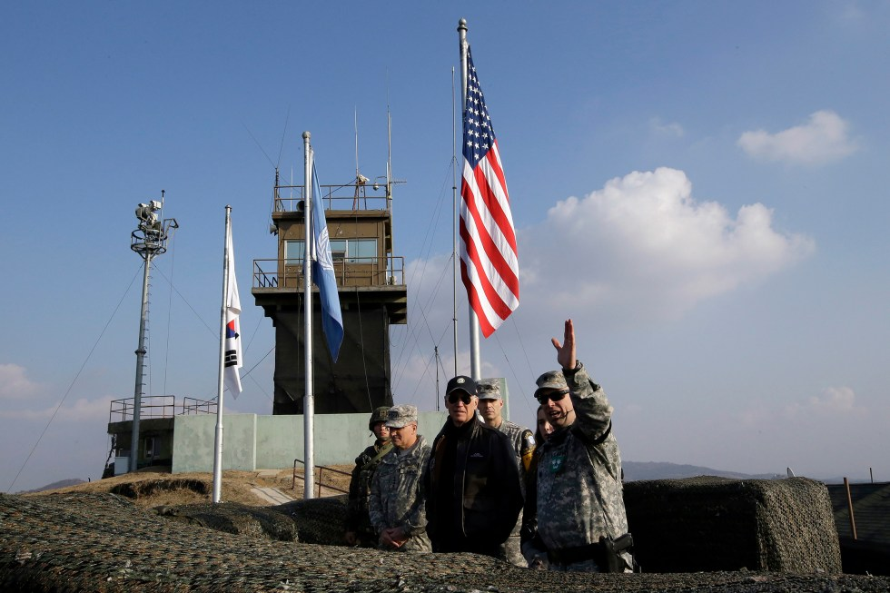 On Dec. 7, 2013, then U.S. Vice President Joe Biden, center, visits Observation Post Ouellette inside the Demilitarized Zone (DMZ), which has separated the two Koreas since the Korean War