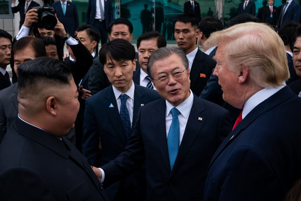 President Donald Trump, President Moon Jae-in, and Kim Jong Un speak outside the Freedom House on the South Korean side of the truce village of Panmunjom, June 30, 2019