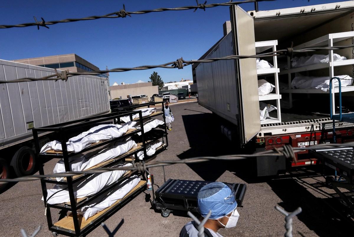 Bodies loaded into a refrigerated temporary morgue trailer in El Paso, Texas, on Nov. 16