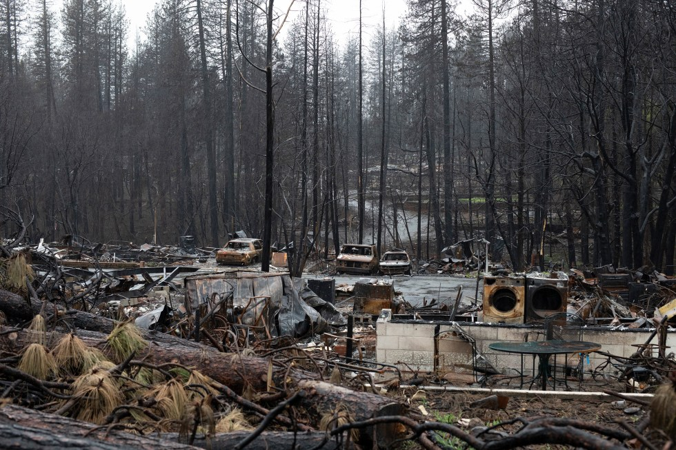 Burned down property in Paradise, strewn with debris