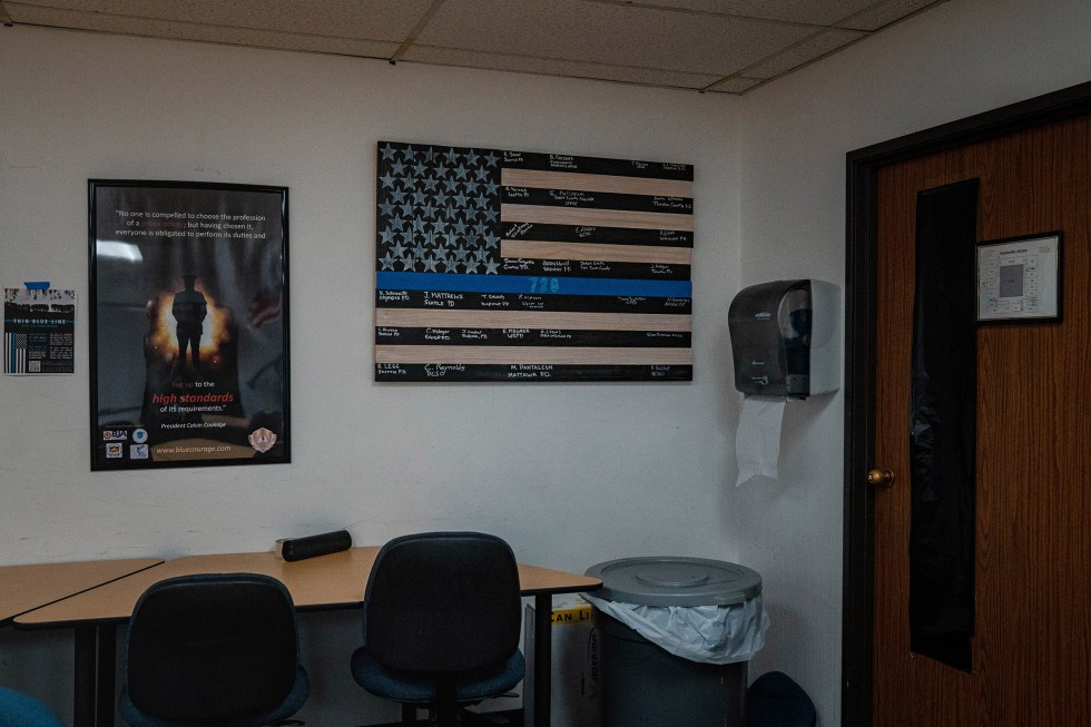A flag on display in an out-of-use classroom.