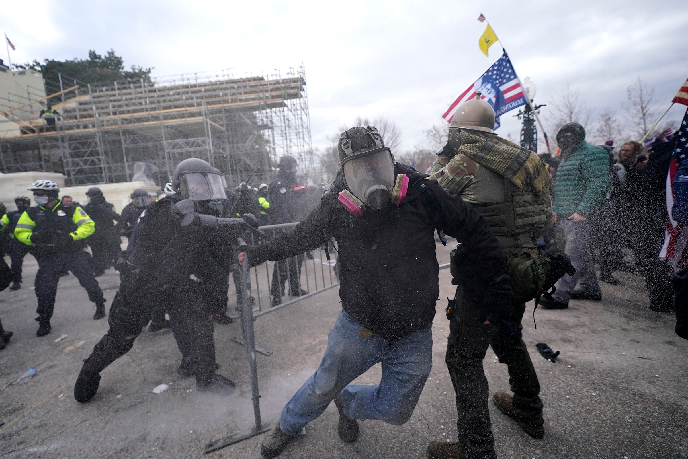 Trump supporters try to break through a police barrier at the Capitol in Washington, on Jan. 6, 2021.