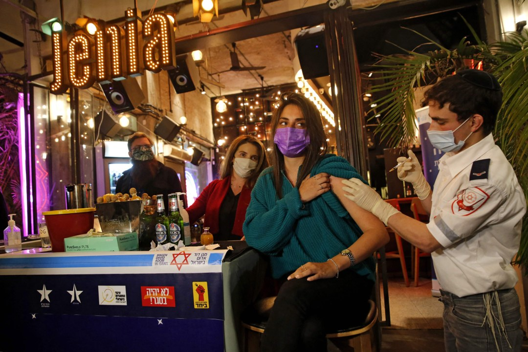 A health worker administers a COVID-19 vaccine at a bar in Tel Aviv on Feb.18, 2021.