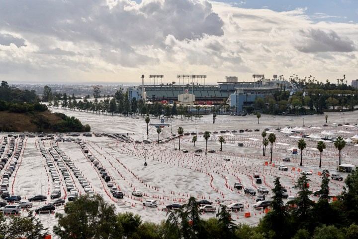 Cars lined up ata vaccination site at Dodger Stadium in Los Angeles on Jan. 29, 2021.