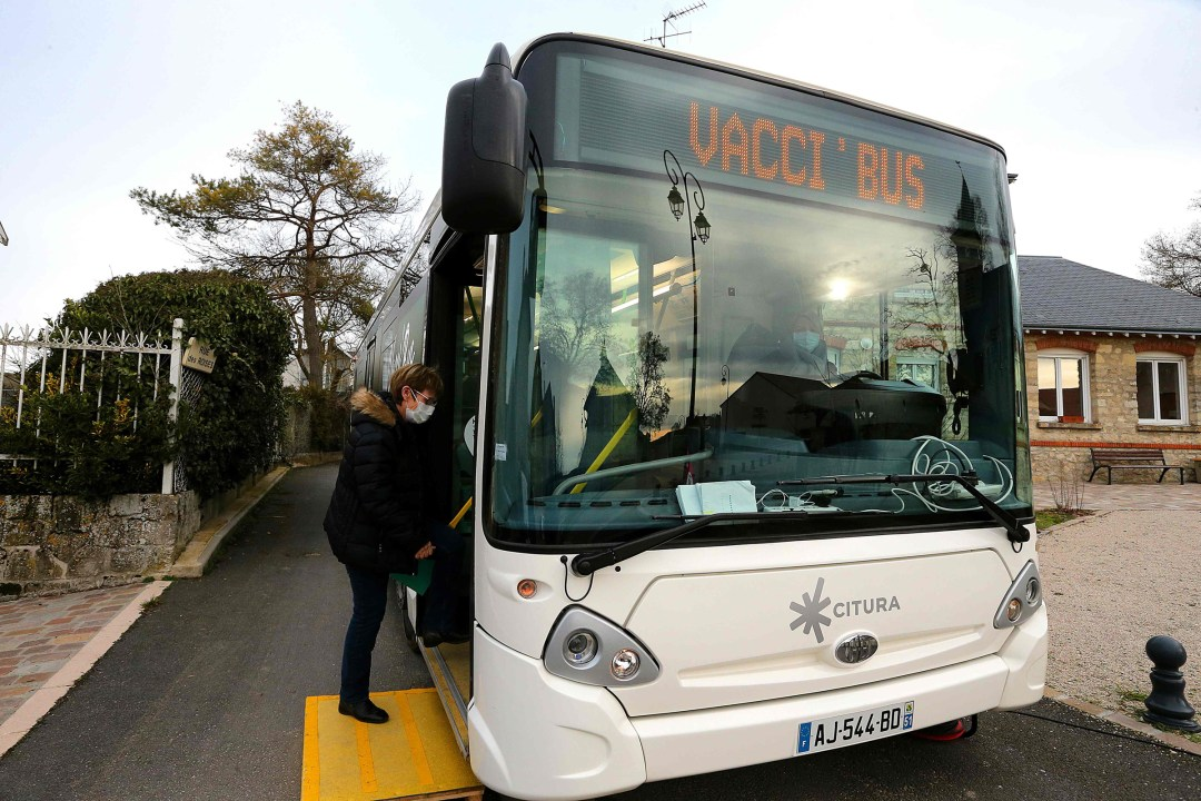 A woman gets in the VACCI'BUS, which goes village to village to enable people with reduced mobility to be easily vaccinated, in Bouleuse, France, on Jan. 20, 2021.