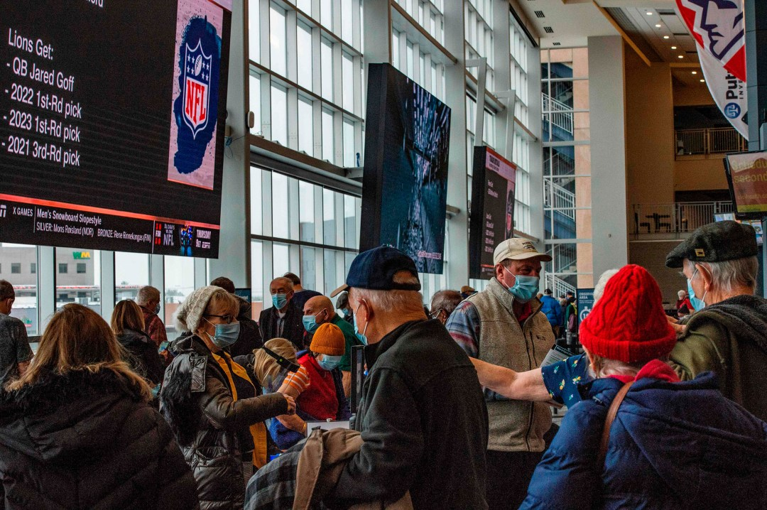 Hundreds of people move through Gillette Stadium in Foxborough, Mass., as they receive their COVID-19 vaccine on Feb. 1, 2021.