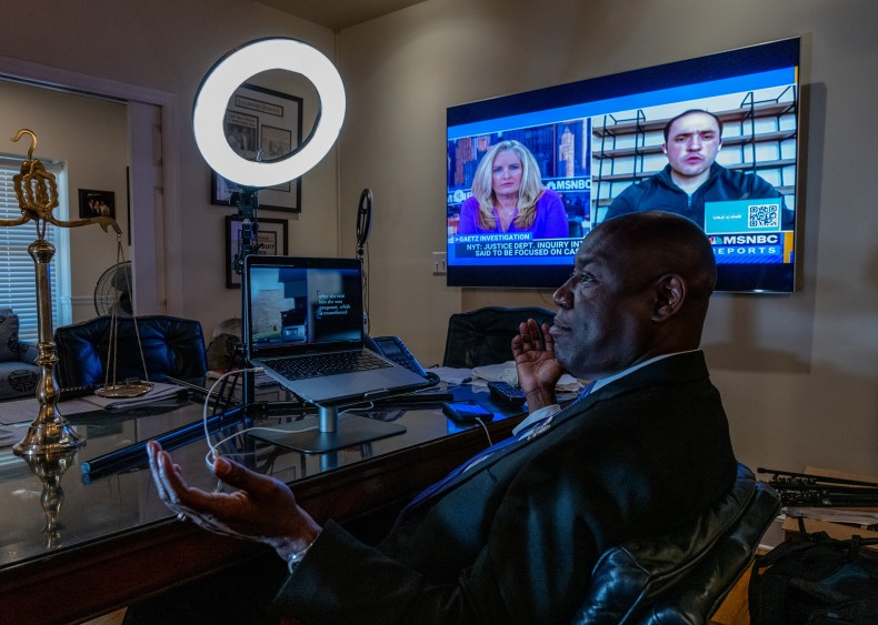 Crump speaks to co-counsel while watching a video of a shooting in his Tallahassee office on April 3.