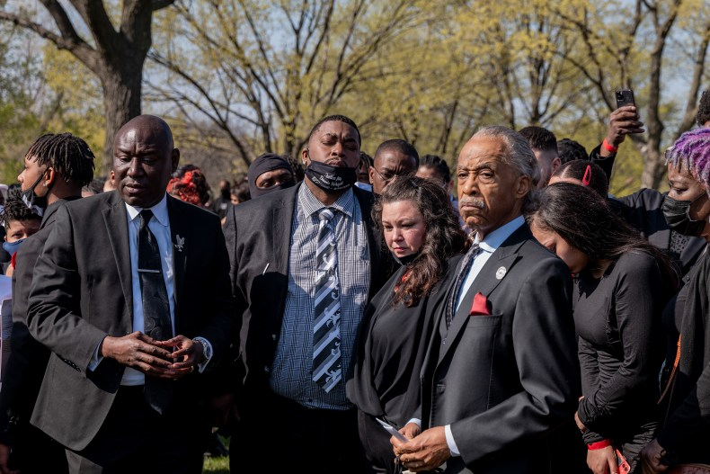 Aubrey and Katie Wright, the parents of Daunte Wright, stand with Crump (far left) and Sharpton (far right), at Lakewood Cemetery after their son's funeral in Minneapolis on April 22.