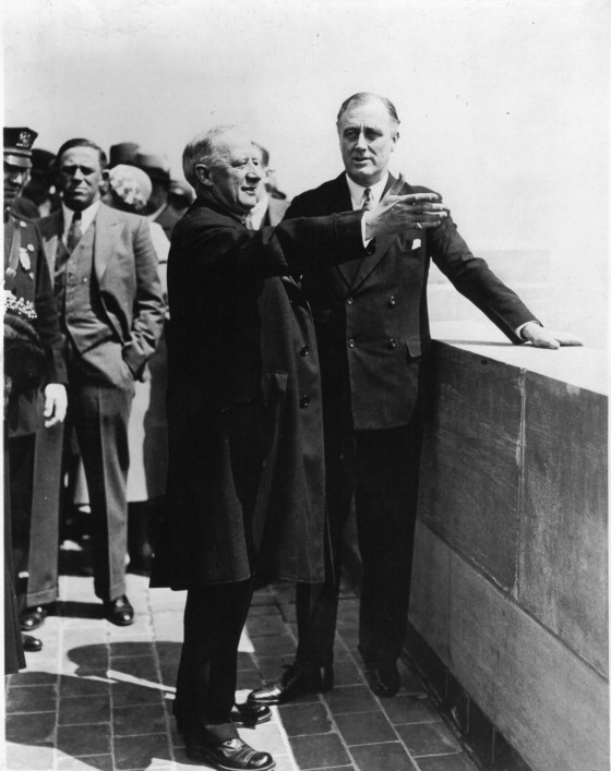 The Empire State Building was formally opened in a ceremony in which President Hoover, Alfred E. Smith, President of the Empire State Corporation, Governor Roosevelt, and other notables participated. This photo shows Ex-Governor Smith pointing out the sights of the city to Governor Roosevelt from 1 of 2 observation floors on May 1, 1931.