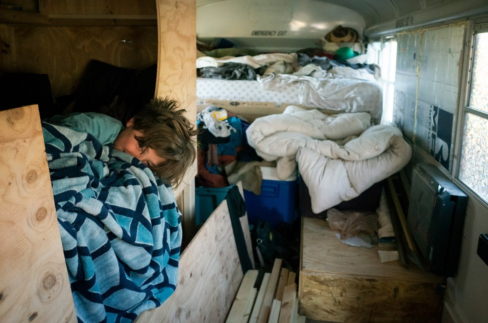 Max snuggles inside his bed in the back of the bus while Paula makes breakfast on Feb. 20.