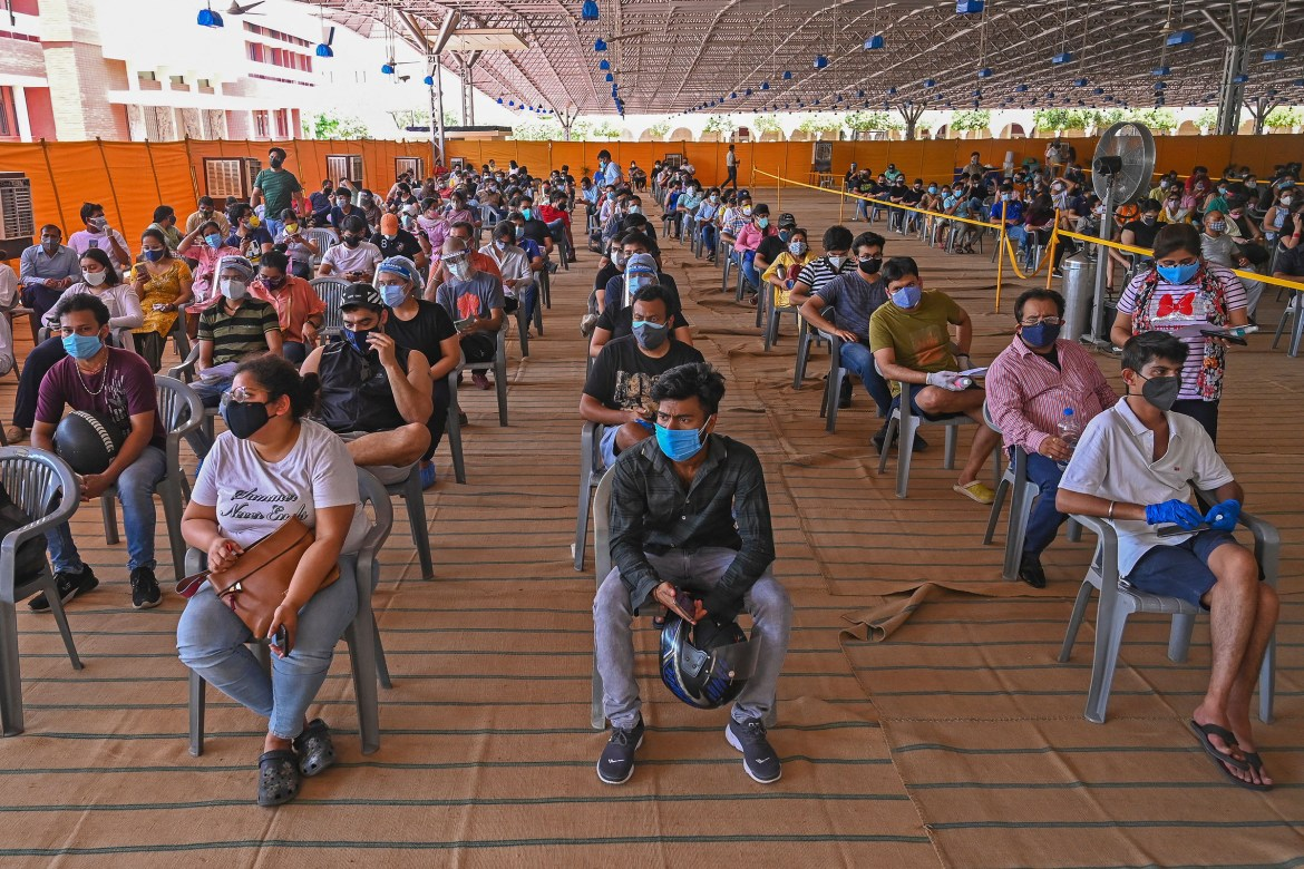 People wait to get a dose of the Covishield vaccine in New Delhi on May 4, 2021.