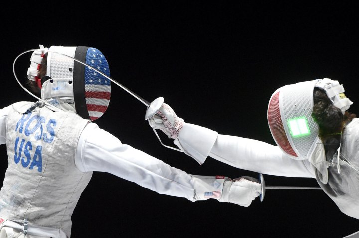 Nicole Ross, left, of the US fights against Ysaora Thibus of France during the third place match for the women's foil team competition of the FIE World Fencing Championships in Budapest, on July 22, 2019.