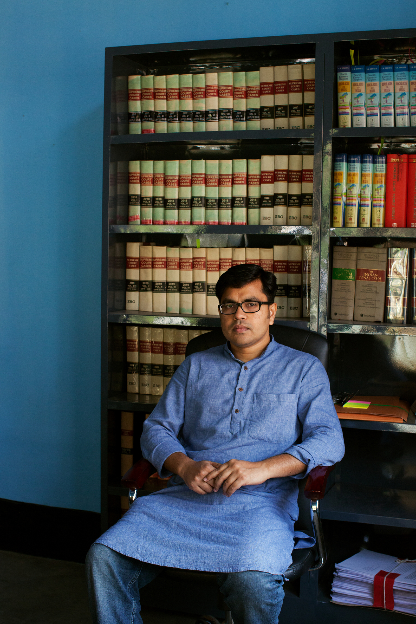Aman Wadud, a human-rights lawyer who provides pro bono legal aid to people fighting citizenship cases, in his office in Guwahati, Assam