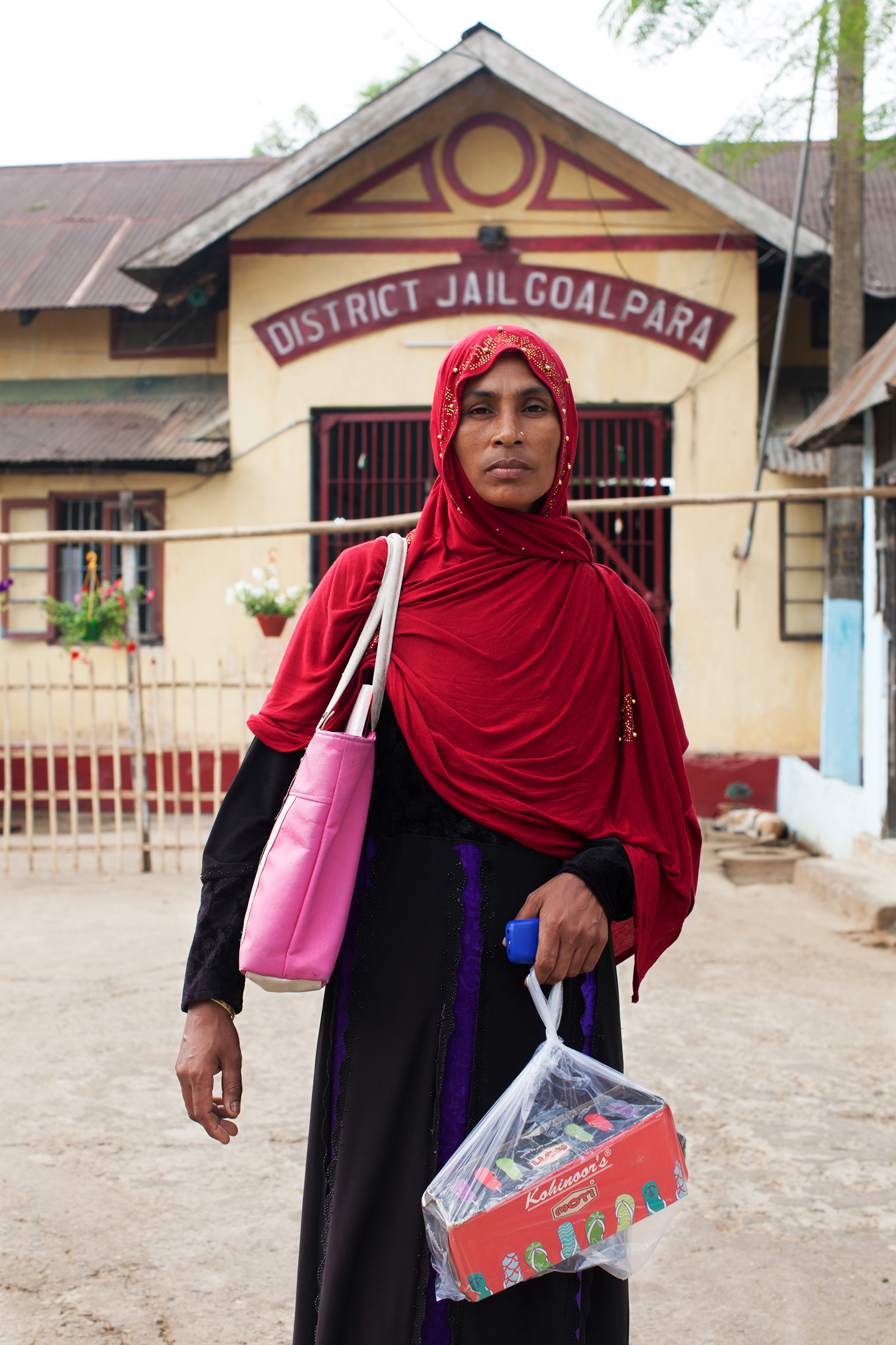 Samiran Nesa outside Goalpara district jail, where she is visiting her husband Sohidul Islam and carrying shoes to give him. Islam has been detained since December 2019, after a foreigners tribunal declared him an illegal immigrant