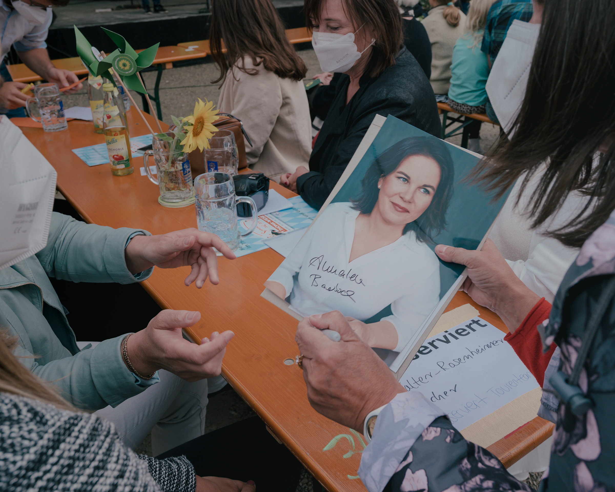 Baerbock hands her autograph to a supporter at the beer garden as part of a campaign event in Dachau