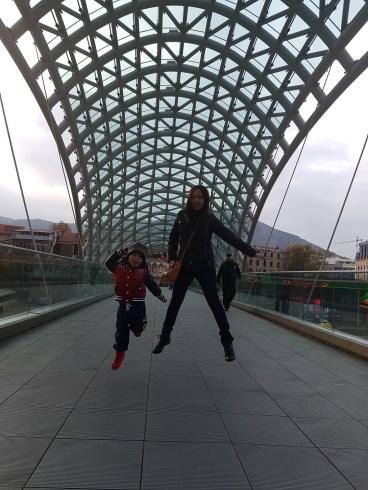 mother & son jump shot at the Peace Bridge