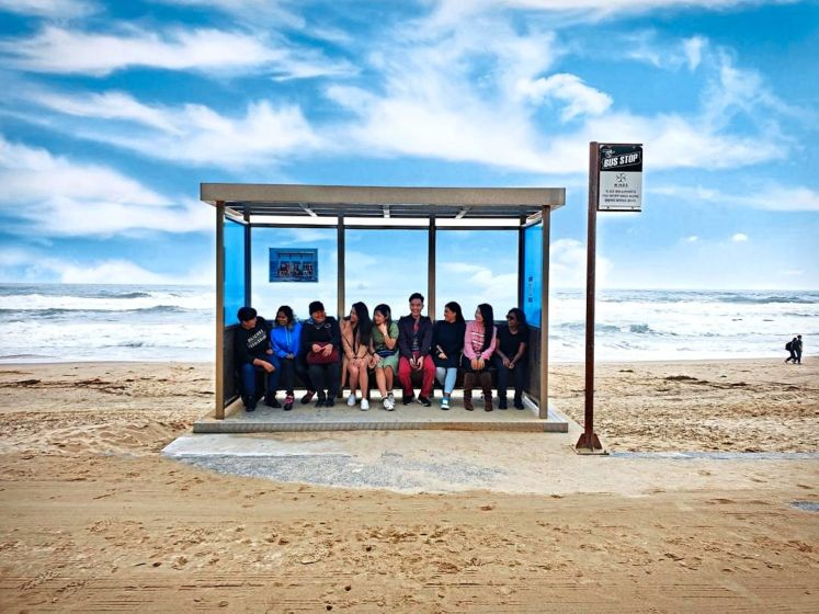 The writer with other Malaysian media reps trying to recreate the iconic  photo of BTS from their album 'You Never Walk Alone' at Jumunjin Beach. — KTO/Gangwon Province