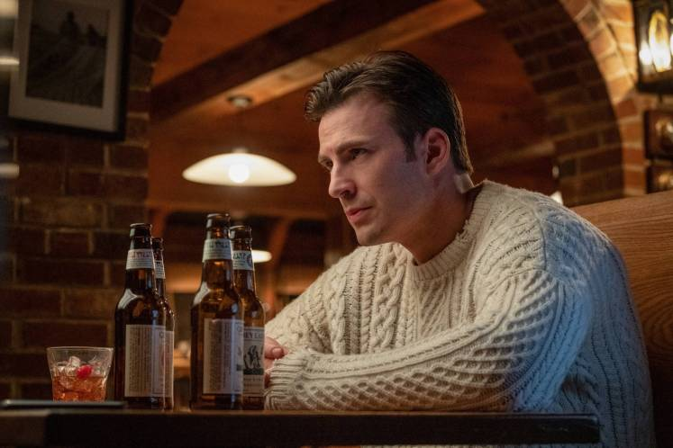 'Why am I always in movies with such huge cast?' Ransom (Chris Evans) has a drink as he contemplates current affairs.